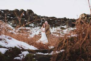 Recently married couple poses in the snow, johnhope14