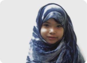 A young girl wearing a hijab