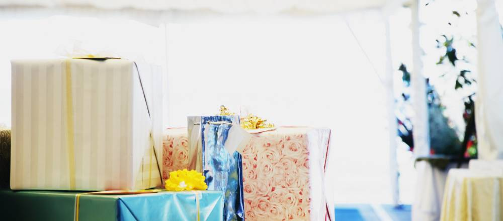 Some parties or weddings will have a table set aside for you to drop your wedding gift off at.