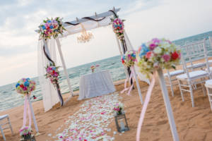 A destination wedding on a beach has become fairly common as the scenery is beautiful.
