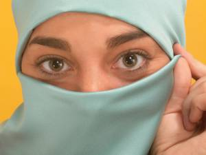 Muslim woman's eyes peering through a traditional hajib