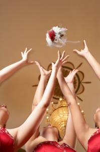 European wedding tradition involving bridesmaids reaching for bouquet