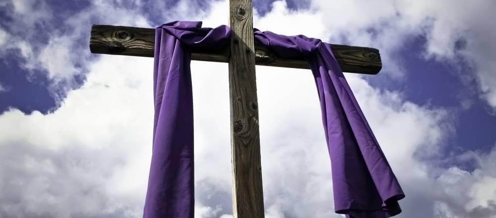 Cross with purple fabric draped on it