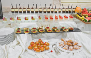 Food stations are a fun and flexible option for any type of wedding, and you should consider them when planning your wedding reception meal options.