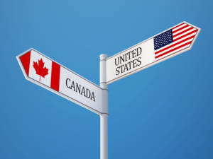 sign pointing to canada and united states